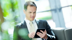 Male Caucasian business manager using office tablet technology - stock footage