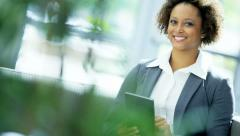 Portrait of African American female real estate consultant with wireless tablet - stock footage