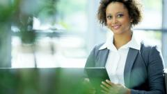 Portrait of female ethnic US advertising manager using tablet technology - stock footage