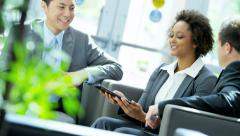 Young multi ethnic business people in city office using touch screen tablet - stock footage