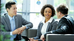 Multi ethnic male female in business meeting using tablet technology - stock footage
