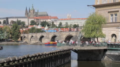 View of Charles Bridge & Vltava with St. Vitus Cathedral and Royal Palace, Stock Footage