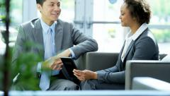 Smart young multi ethnic male female finance team using tablet technology - stock footage