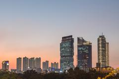Sunset over Jakarta business district - stock photo