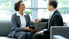Ambitious multi ethnic businessman businesswoman in meeting using technology - stock footage
