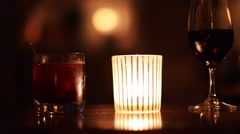 Stock Video Footage of Zoom out from drinks and candlelight.