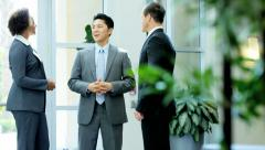 Young male female multi ethnic business people in finance meeting - stock footage