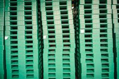 Green plastic pallets in warehouse. - stock photo