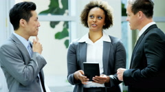 Multi ethnic male female business financial team using tablet technology - stock footage