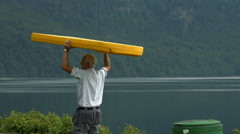 A construction worker carrying a big plastic board, Neuschwanstein Castle Stock Footage