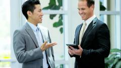 Young multi ethnic male female business finance team using wifi tablet - stock footage
