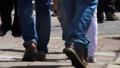 People walking on the sidewalk: particular on legs and feet Stock Footage
