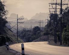Asphalt curve road with mountain background Stock Photos