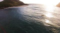 Aerial 360 pan of Hawaiian surfer. Stock Footage
