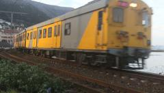 Metrorail commuter train in Kalk Bay Stock Footage