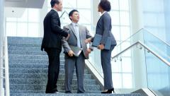 Male female handshake multi ethnic business team in planning meeting - stock footage