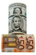 Currency dollars and euros rolled on the white background Stock Photos