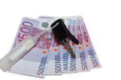 banknotes of 500 euros and the car keys - stock photo