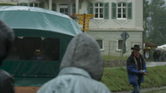 A green carriage and cars on the street near Neuschwanstein Castle Stock Footage