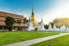 The golden pagoda at Wat Suan Dok, Chiangmai, Thailand, with beautiful blue s - stock photo