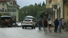 Traffic on the street between Schlosshotel Lisl and Muller Hotel, Neuschwanstein Stock Footage