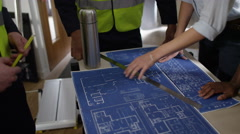 4k Confident female engineers looking at blueprints with male colleagues Stock Footage