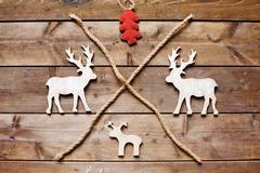 Reindeers and firtree Stock Photos