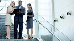Smart multi ethnic business people meeting together in city office - stock footage