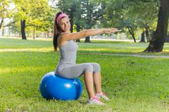 Fitness ,Healthy, Aerobics, Workout, Smiling Young Woman doing exercise with  Stock Photos
