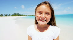 Stock Video Footage of Portrait of a cute young Caucasian girl on a tropical beach