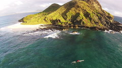 Surfer at Mokulua Islands, Hawaii lifestyle. Stock Footage