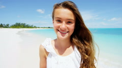 Portrait of a smiling teenage Caucasian girl on an island beach - stock footage