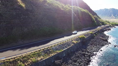 Truck drives down scenic road, Hawaii aerial. Stock Footage