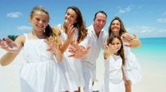 Portrait of a Caucasian family on an ocean island beach vacation - stock footage