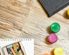 Gouache paints and pastel crayons close-up. Stock Photos