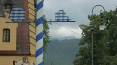 Bavarian flag on a street pole, Neuschwanstein Castle Stock Footage