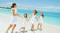 Caucasian mother and her three daughters together on an island vacation - stock footage