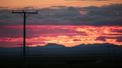Colorful sunset over country power lines, Iceland Stock Footage