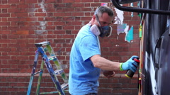 Upfest 2015 in Bristol: writer painting on the wall with spray bottle Stock Footage