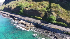 Truck drives down scenic road, Hawaii aerial. - stock footage