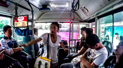 The passengers board the bus in Dalian, China. Stock Footage
