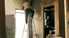 Indian bricklayers at work, Varanasi, India Stock Footage