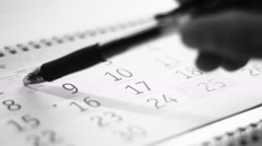 A date on the calendar - stock footage