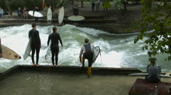 Surfing and falling in Eisbach, Munich Stock Footage