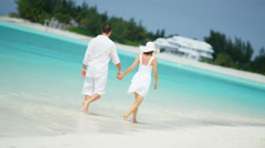 Attractive Caucasian couple enjoying their vacation at an ocean beach resort - stock footage