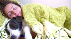 Sleepy Smiling Woman and Her Dog in the Bed Stock Footage