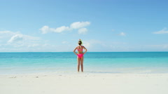 Female Caucasian child on a tropical ocean beach wearing a snorkel - stock footage