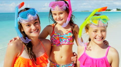 Portrait of young Caucasian sisters enjoying water fun with snorkels on vacation Stock Footage
