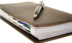 business notebook isolated on background - stock photo