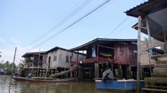 Riverside Slums & Fishermen Life in Village Houses on Water Stock Footage
